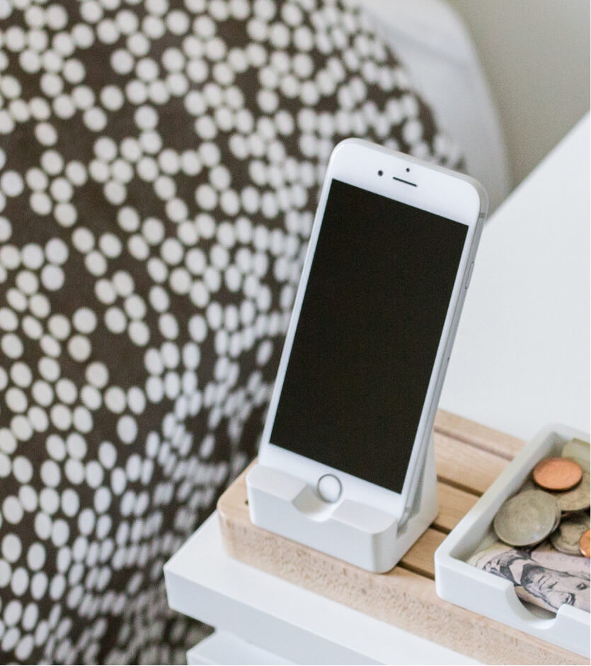 Phone charging on nightstand